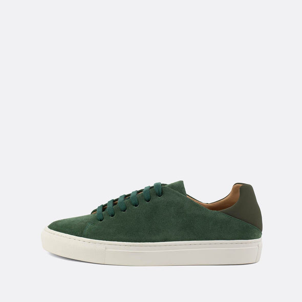 Fun casual sneakers in green suede with contrasting neoprene heel counter.