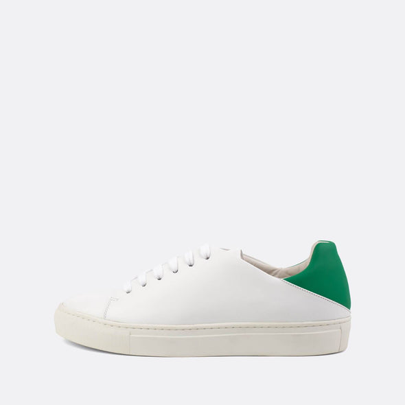 Fun casual sneakers in white leather with contrasting vibrant green neoprene heel counter.