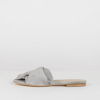 Elegant slippers with large loose knot in light grey suede