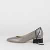 Smoke grey pumps in leather with thin adjustable ankle elastic and short block heel in black with silver metallic applique