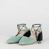 Mint green pointed toe pump sandals in leather with thin black elastic ankle ties and block comma heel in black