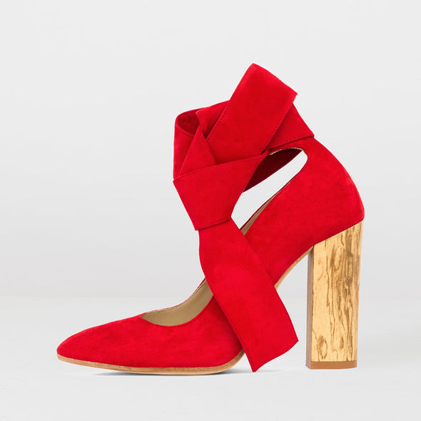 High-heeled pointed toe pumps in red suede with wooden block heel and ankle-wrap ties