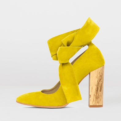 High-heeled pointed toe pumps in canary yellow suede with wooden block heel and ankle-wrap ties