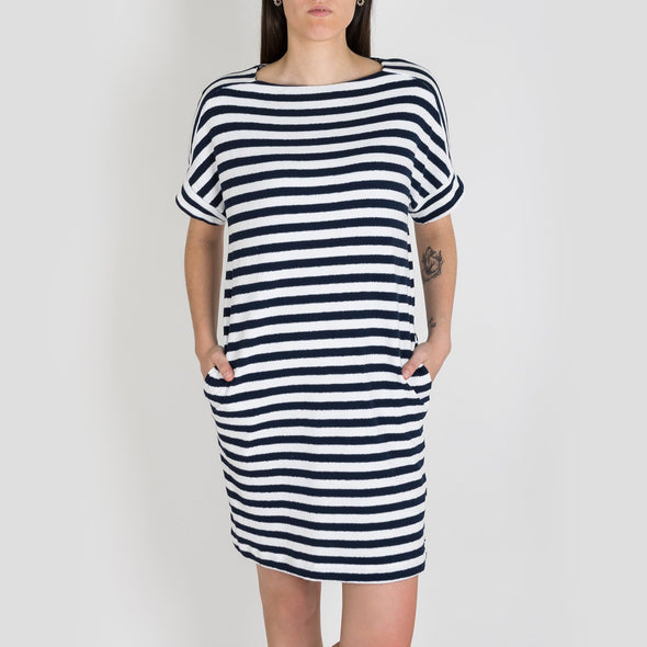 Blue and white manipulated stripe t-shirt dress featuring a half sleeve, side splits and a dropped hem.