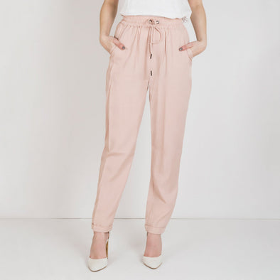 Relaxed-fit peached tencel jogger featuring an elasticated waist with an adjustable drawstring and stitch deatiling.