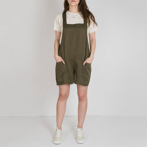 Olive colored dungaree playsuit.