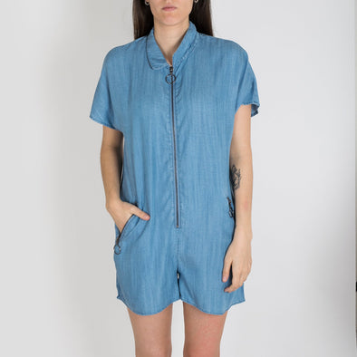 Relaxed fit playsuit cut from soft touch tencel with a curved collar, front circle hardware zip detailing and side pockets.