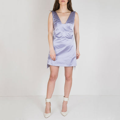 Little mauve dress with open back and side pockets. Fastens with a concealed side zipper.