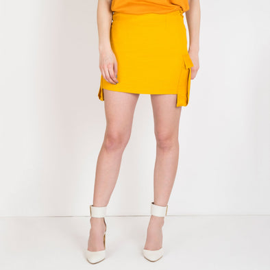 Mini-skirt with side pockets and crossed cords to define waist.