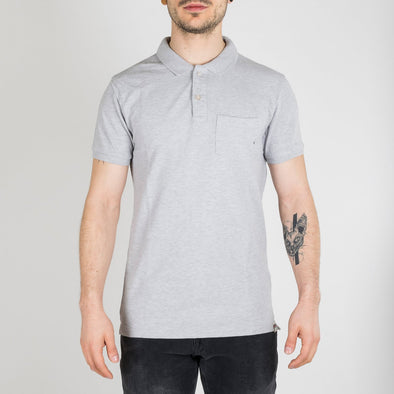 Garment dyed polo for a faded look. The polo is designed with a logo detailed chest pocket, short sleeves and a two-button polo collar.