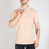 Marshmellow garment dyed polo crafted from cotton pique.