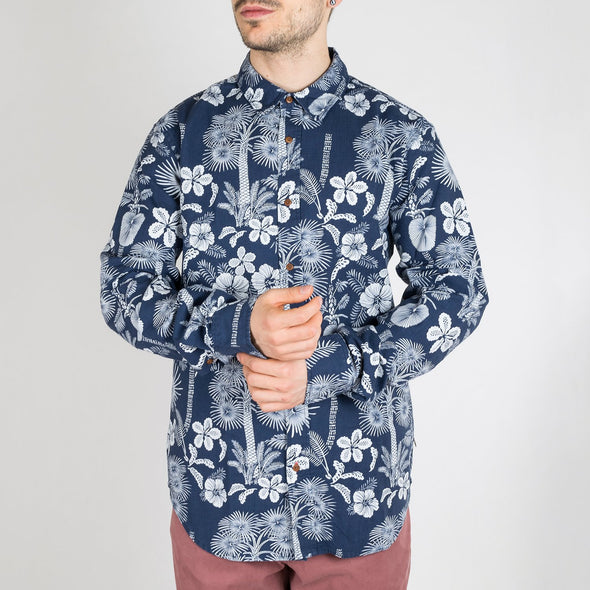 Navy blue and white flower printed shirt with long sleeves.
