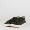 Minimalist low sole laced sneakers in forest green soft shiny leather