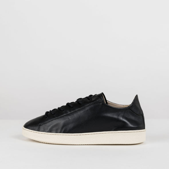 Minimalist low sole laced sneakers in black soft shiny leather