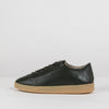 Minimalist low sole laced sneakers in black soft shiny leather with beige sole