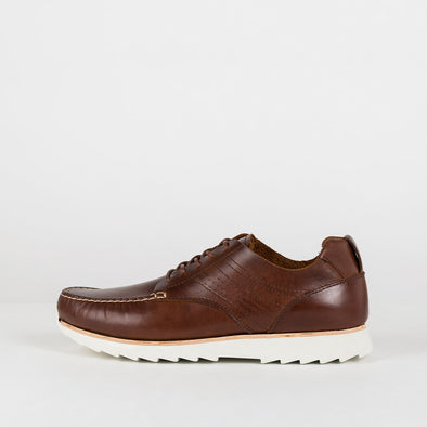 Brown moccasin inspired body mixed with a spiky comfortable sole.