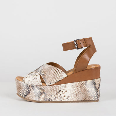 Platform sandals with cross-strap toe and ankle buckstrap in creamy snake texture print and cognac brown panels