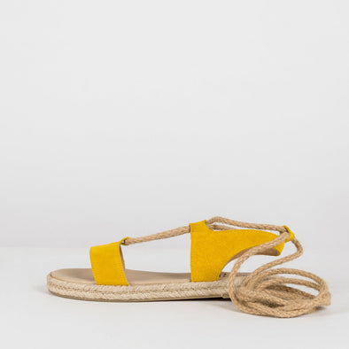 Gladiator-style lace-up sandals in yellow suede with rope laces and espadrille sole