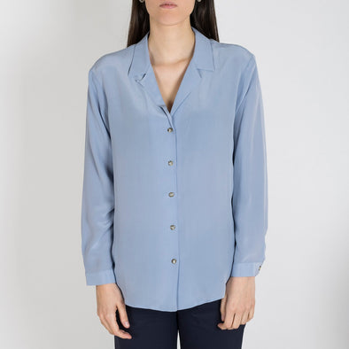 Light blue silk shirt with long sleeves and neck details.