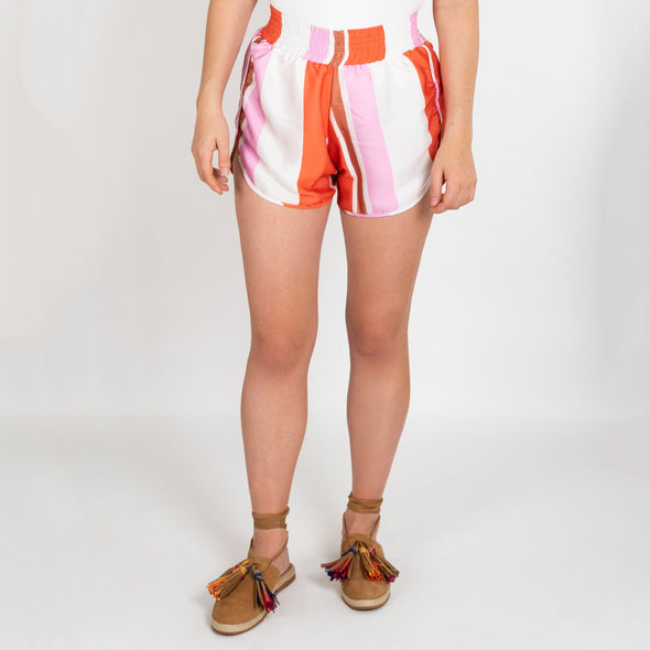 Striped shorts with elastic detail and inseam pockets.