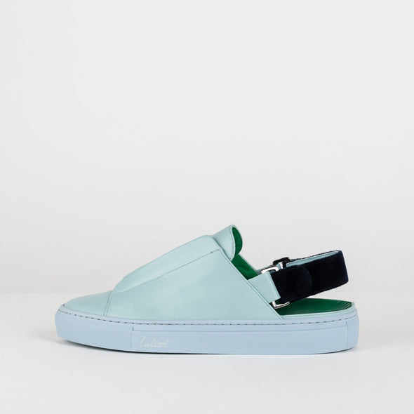 Low top cut-out ankle sneakers in blue leather with interchangeable straps for the ankle.