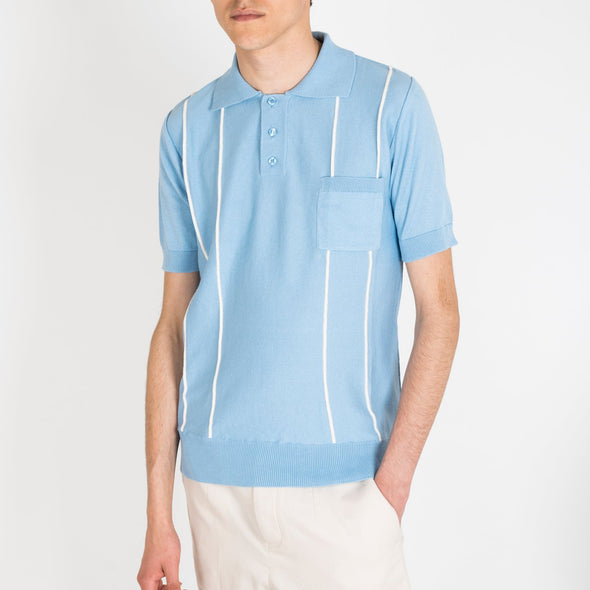 A light-medium weight polo-shirt, with short sleeves, three-button placket, white vertical straps and a left chest pocket.