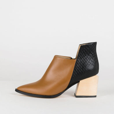 Geometric pointed toe ankle boots in black and camel leather.