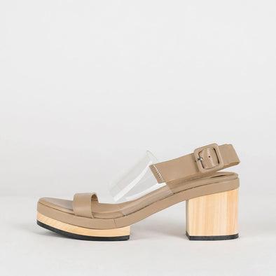 Classic nude leather open sandals with vinyl strap.