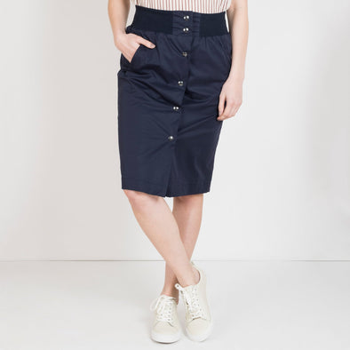 Black mid-length skirt with buttons at the front.