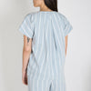 Crease-resistant, striped, short sleeve top with pleated back in a unique, highly wearable blend, giving it a natural linen look and feel.