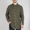Green cotton-linen shirt with inside chest pocket.