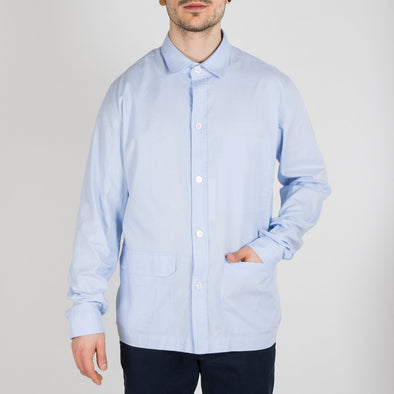 Sky blue colored overshirt with inside chest pocket and two front patch pockets.
