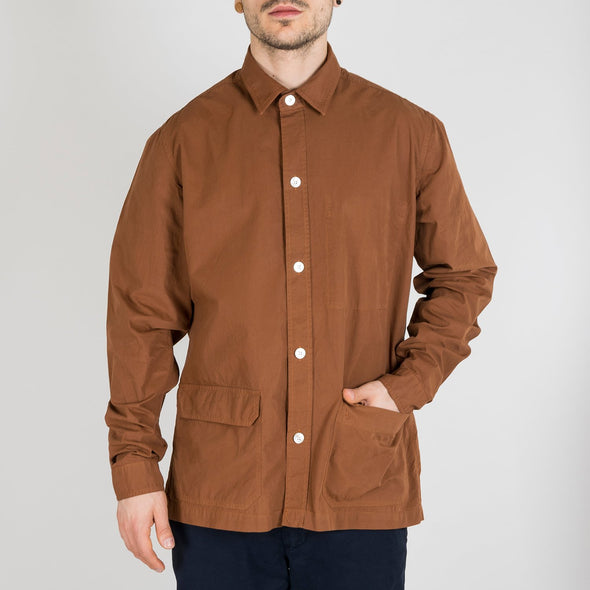 Rusty colored overshirt with inside chest pocket and two front patch pockets.