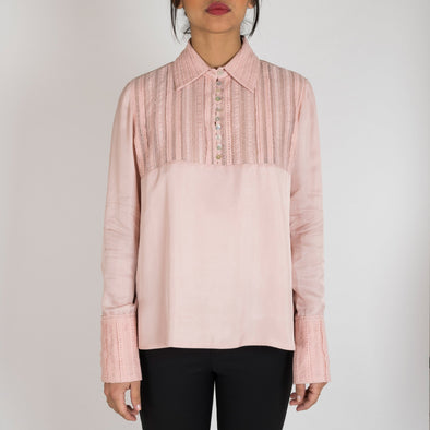 ca41b39ccec8e Light pink blouse with lace details and pearl buttons.