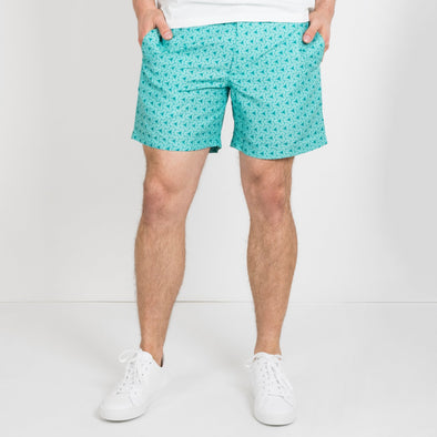 Nomad swim shorts in a Cala Salada turquoise waters inspired print.