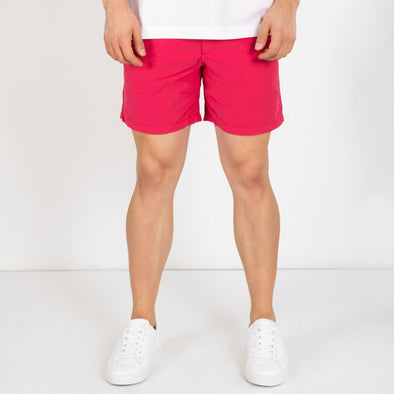 Nomad swim shorts in a Tinto de Verano inspired color.