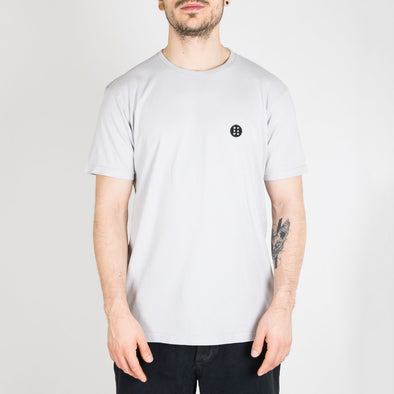 "Light grey t-shirt with ""Essential"" patch on the chest."