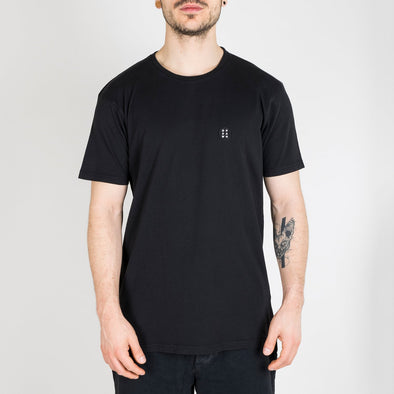 "Deep black t-shirt with ""Essential"" patch on the chest."
