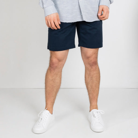 Navy blue chino shorts with embroidery details and inside print.
