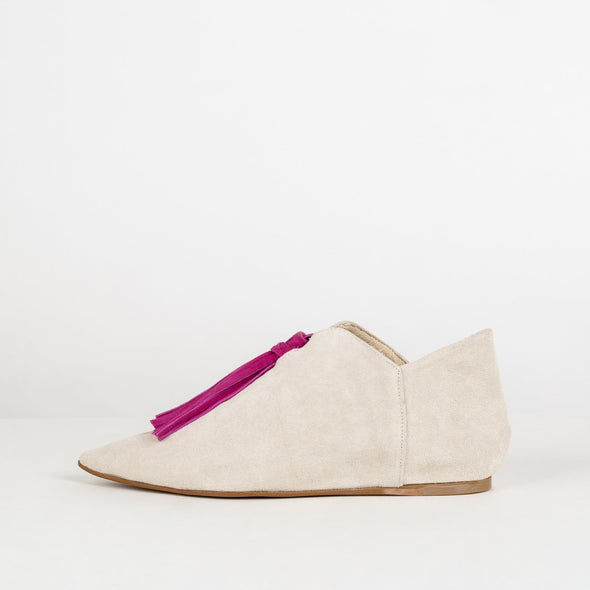 Sand suede ankle shoes with pink tassel.