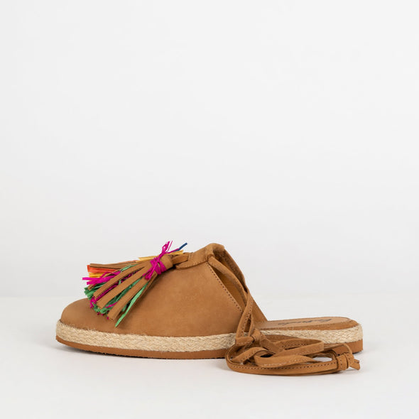 Open espadrilles at the back with camel suede body and a colorful tassel applique.