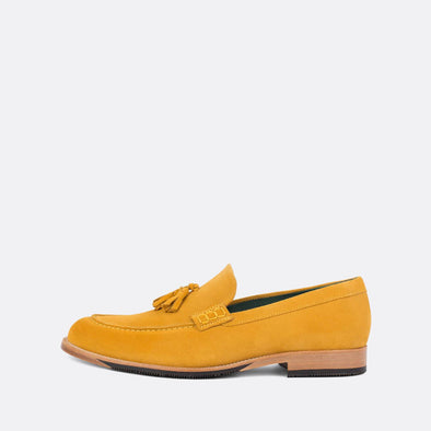 Casual loafers in vibrant yellow velour with tassel detail.