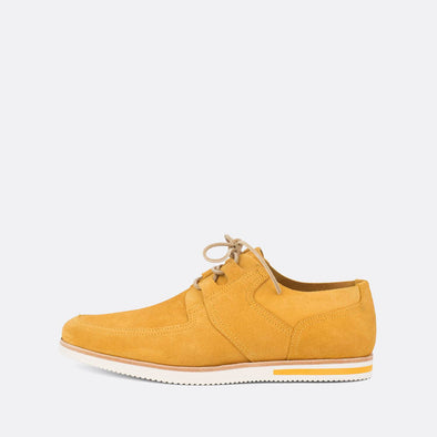 Comfortable vibrant yellow suede shoes with a distinct sole.