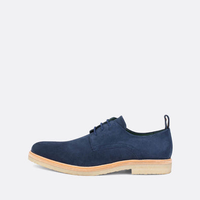 Blue suede derby shoes with neutral toned sole.