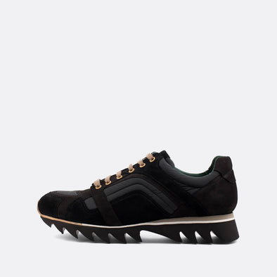 Man's edgy black sneakers with a distinct sole.