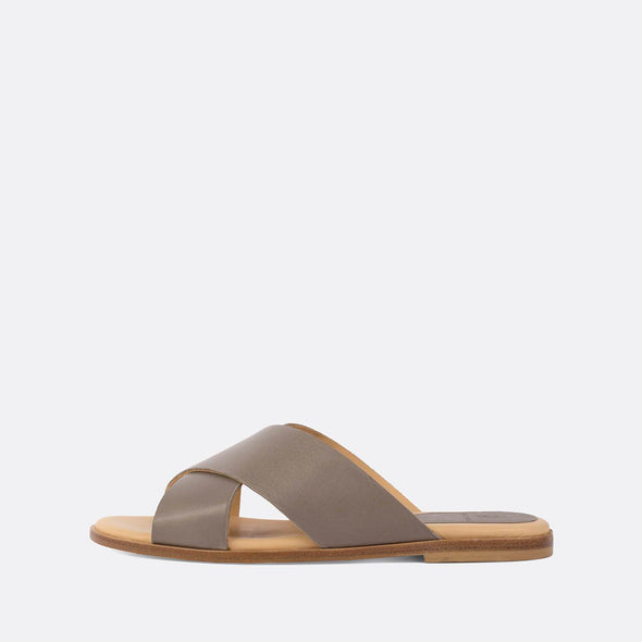 Minimalist cross-strap slides in grey leather.