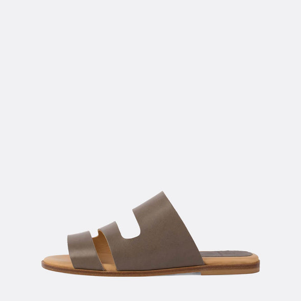 Minimalist triple-strap slides in grey leather.
