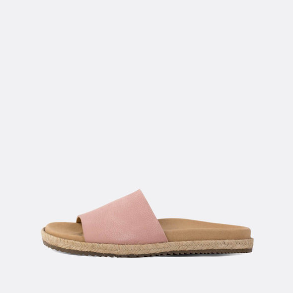Minimalist pink leather one-strap slides with raffia sole.