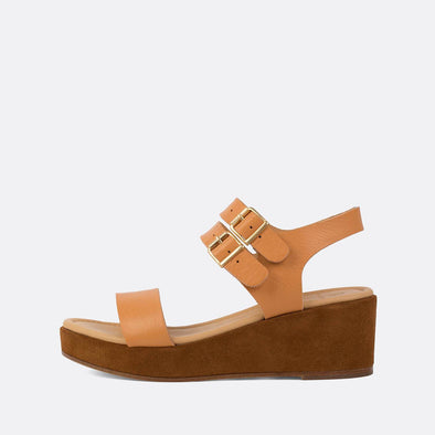 Minimalist peachy sandals with brown suede platform sole.