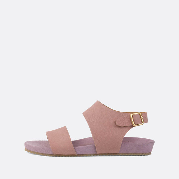 Minimalist double-strap sandals in light pink leather.